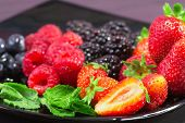 image of greedy  - greedy red fruits close up with mint leaf - JPG