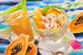 picture of papaya fruit  - glass of fresh fruits smoothie and salad with papaya  - JPG
