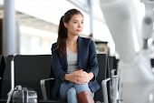 stock photo of carry-on luggage  - Airport woman waiting in terminal - JPG