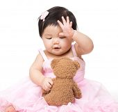 image of baby doll  - Asian baby girl play with doll - JPG