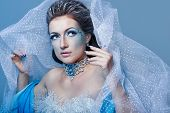image of snow queen  - Attractive girl with scenic makeup in the image snow queen - JPG