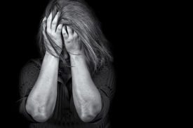 stock photo of weeping  - Black and white image of a young woman crying useful to illustrate stress - JPG