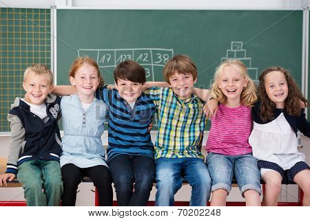 Group Of Happy Laughing Children In School
