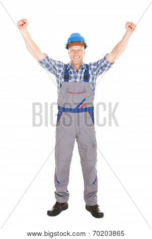 Manual Worker Screaming With Hands Raised