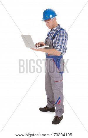 Manual Worker Using Laptop