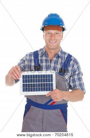 Confident Repairman Holding Solar Panel