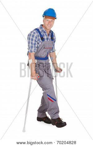 Handyman Walking With Crutches