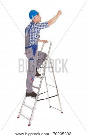 Repairman Climbing Step Ladder