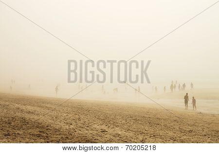 People In Fog Beach