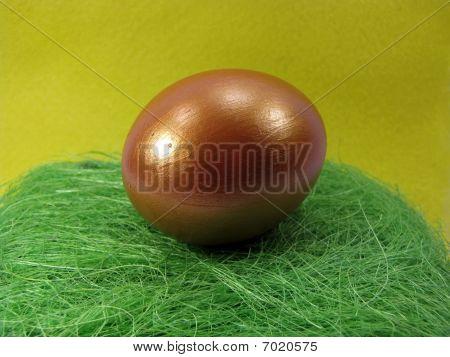 Golden Egg on green nest