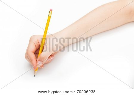 Female hand writing with a pencil on a white background