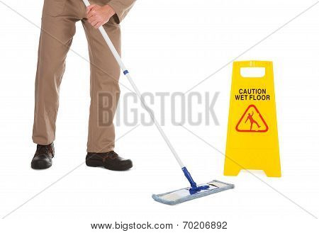 Servant Mopping Floor Over White Background