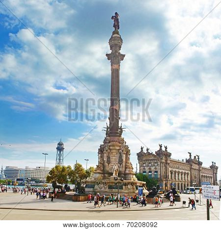 Tourists Walking Near Columbus Monument In Barcelona, Spain