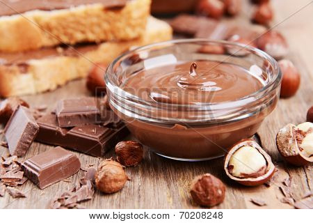 Sweet chocolate cream in bowl on table close-up