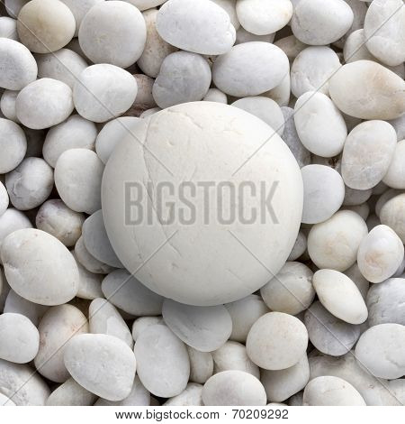 Big white rock laid on small round pebble, circle stone