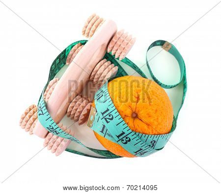 Orange and roller massage wrapped in a tapeline on white background isolated