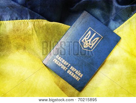 blue yellow flag and passport of Ukraine