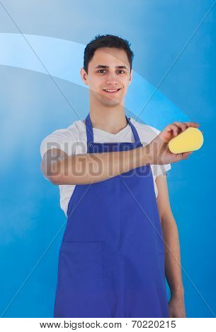 Male Servant Cleaning Glass With Sponge