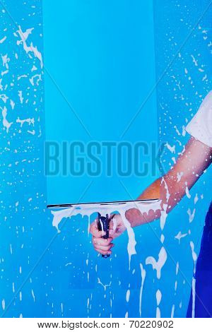 Cropped Image Servant Cleaning Glass With Squeegee