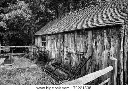 Black And White Landscape Of Old Blacksmiths Workshop In Victorian Times