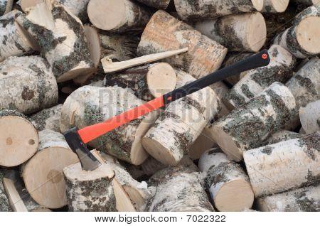 Axe Thrust In A Wooden Stub
