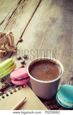 Macaroons, Espresso Coffee Cup And Sketch Book On Wooden Rustic Table