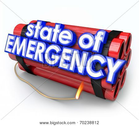 State of Emergency words in 3d blue letters on a dynamite bomb as an explosive crisis or disaster is about to blow up
