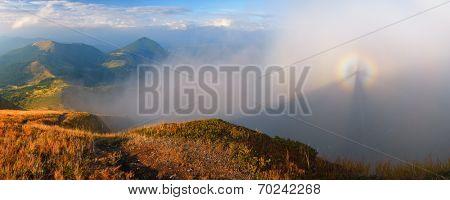 Landscape panorama autumn day. Beautiful gloria in the fog