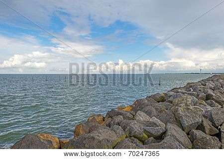 Clouds over a dike in a lake