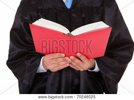 Judge Holding Statute Book