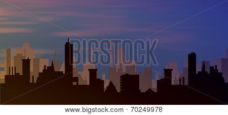 silhouette of town with sunset and clouds in sky