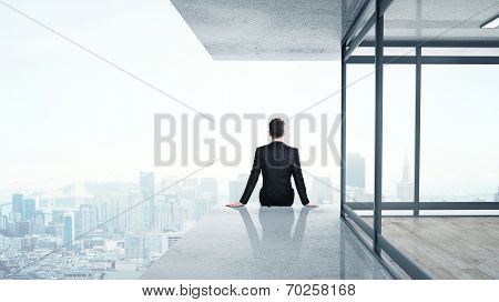 Man Sitting On Skyscrapper