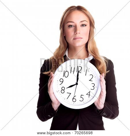 Portrait of beautiful blond woman wearing suit holding in hands clock, isolated on white background, eight o'clock, come to work in time