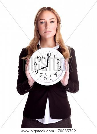 Portrait of serious business woman holding in hands big clock isolated on white background, eight o'clock, get up early in the morning