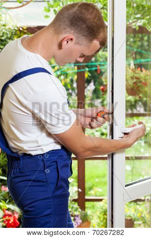 Man During Window Frame Reparation