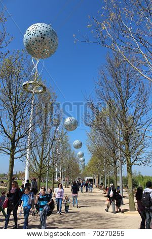 London - April 5. Pierced Aluminium Spheres Hanging Across Pathway On April 5, 2014