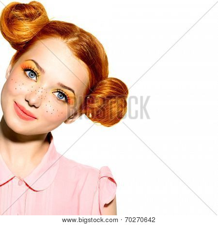 Beauty Model Girl portrait isolated on white. Beautiful Joyful teen girl with freckles, funny red hairstyle and yellow and orange makeup . Professional make up. Isolated on a white background