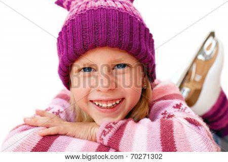 Blonde Girl Lying On Ice In Ice Skates
