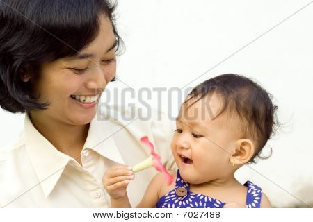 Asian Working Mother And Baby
