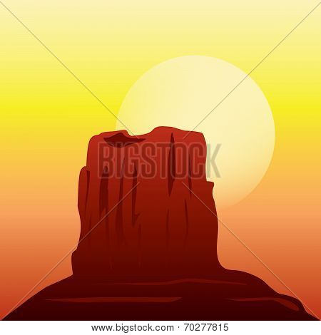 Desert rock formation in the sunset