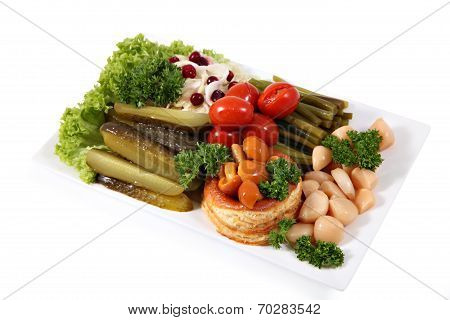 Assorted Pickled Vegetables On The Plate, Isolated Over  White Background