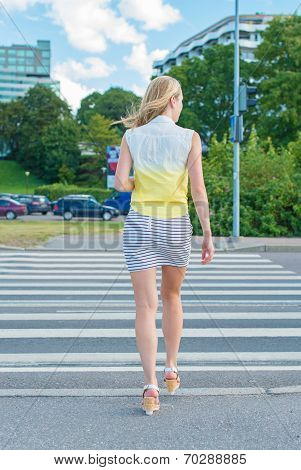 Woman Crossing The Road At Pedestrian Crossing.