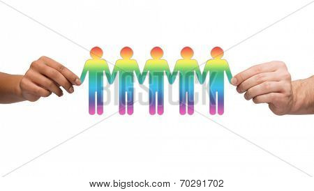 community, unity and teamwork concept - multiracial couple hands holding paper chain gay people