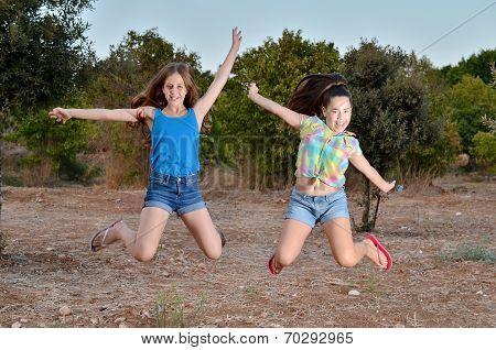 Two Best Friend Girls Jumping