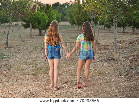 Two Best Friend Girls Holding Hands