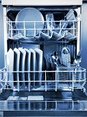 picture of dishwasher  - Inside a dishwasher and dishes in the kitchen - JPG