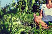 picture of faceless  - Faceless young woman meditating in nature - JPG