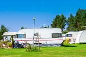 image of trailer park  - Camping life with caravans in nature park - JPG