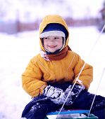 pic of toboggan  - happy boy with sled - JPG