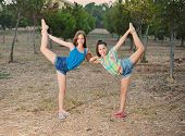 image of do splits  - Two 12 year old teenage girls dancers doing the splits - JPG